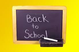 Flyttskolan bild på en griffeltavla som symboliserar en lärande grund.
